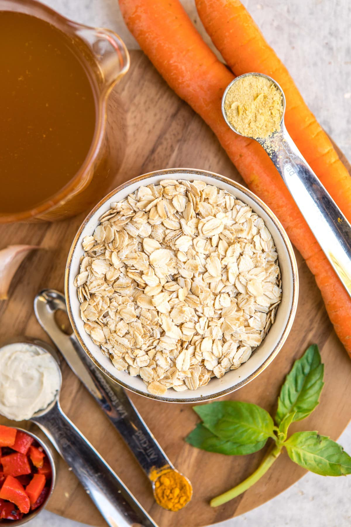 ingredients for savory oatmeal laid out on wood cutting board