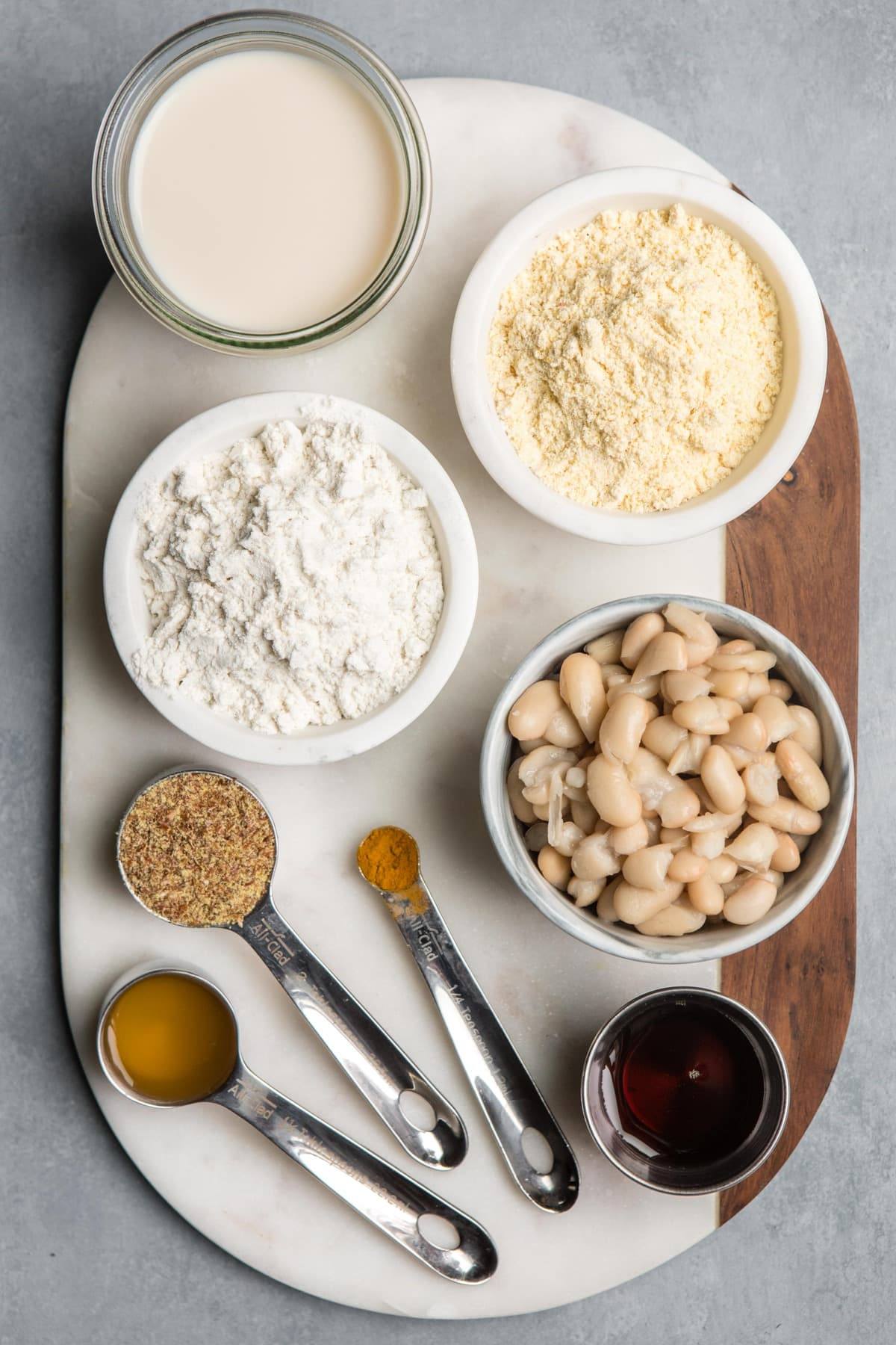 ingredients for vegan cornbread on white marble cutting board