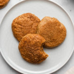 three cashew butter snickerdoodles on small grey plate on marble background