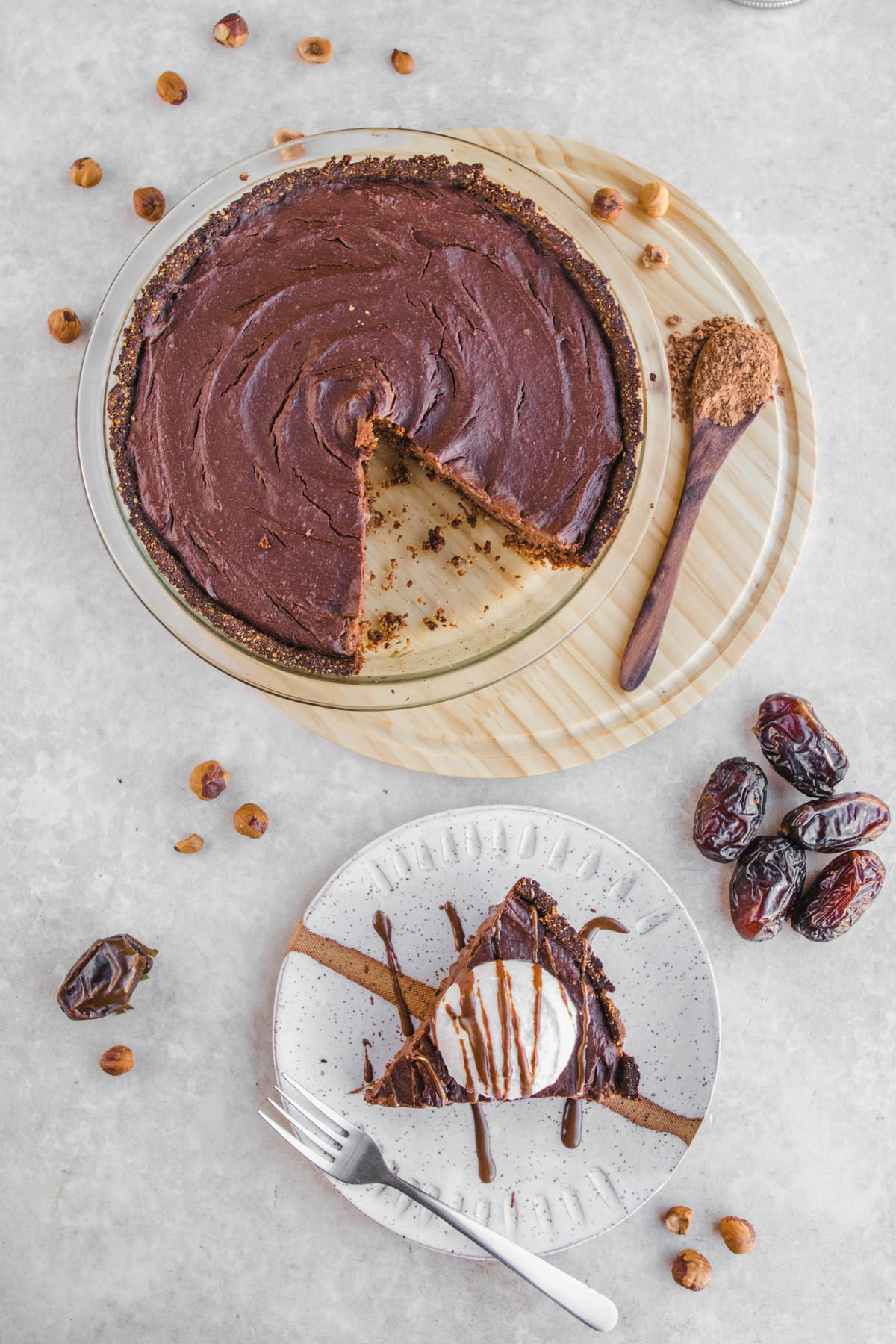 Chocolate Hazelnut Pudding Pie on White Plate with Whipped Cream