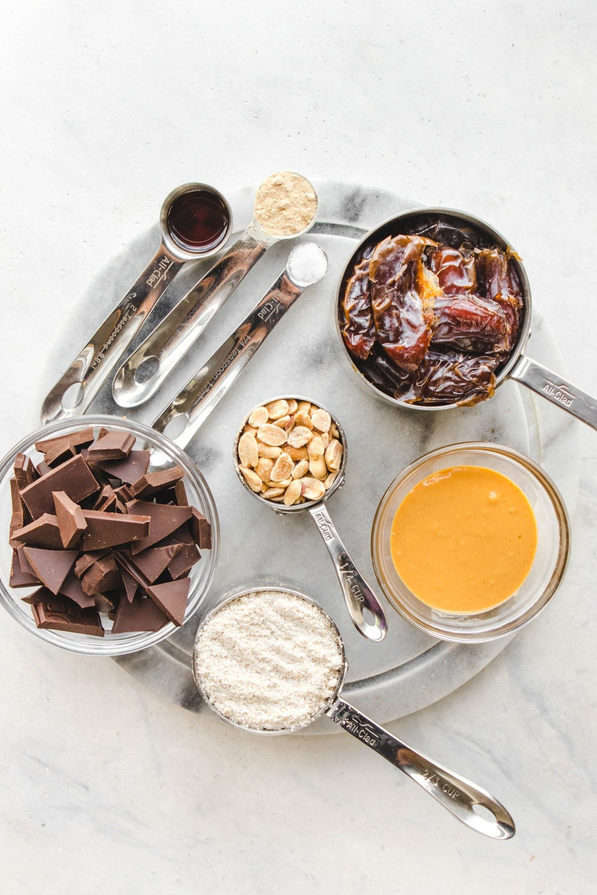 Ingredients for snickers bars on marble cutting board
