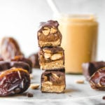 cross section of snickers bars with dates and peanut butter jar