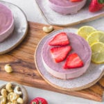 Small Strawberry Cheesecake with lemon on wooden board