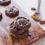 Chocolate Turtle Cookies on wood cutting board