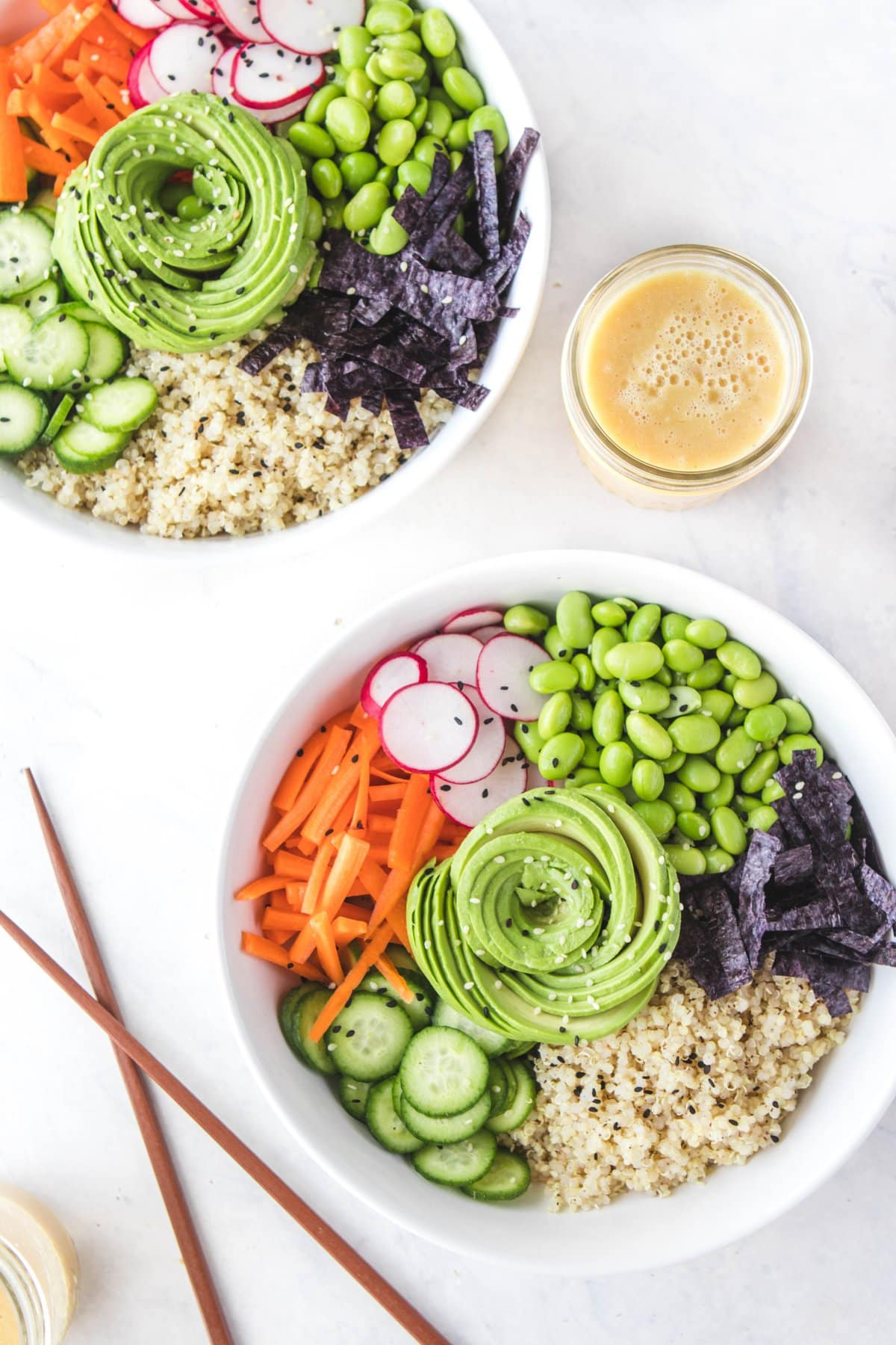 These Quinoa Sushi Bowls with Orange Miso Dressing are gluten free, oil free, and great for vegan meal prep! #sushi #sushibowl #vegansushi #quinoa #plantbased #vegan #buddhabowl #quinoabowl #mealprep via frommybowl.com