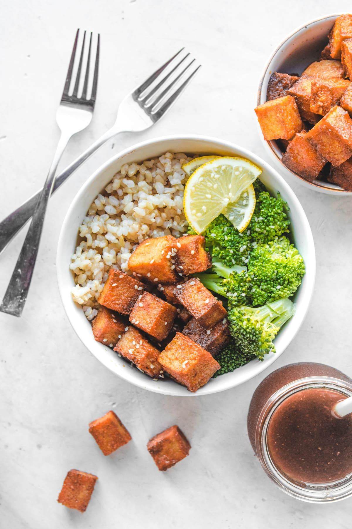 orange tofu bowl with brown rice broccoli