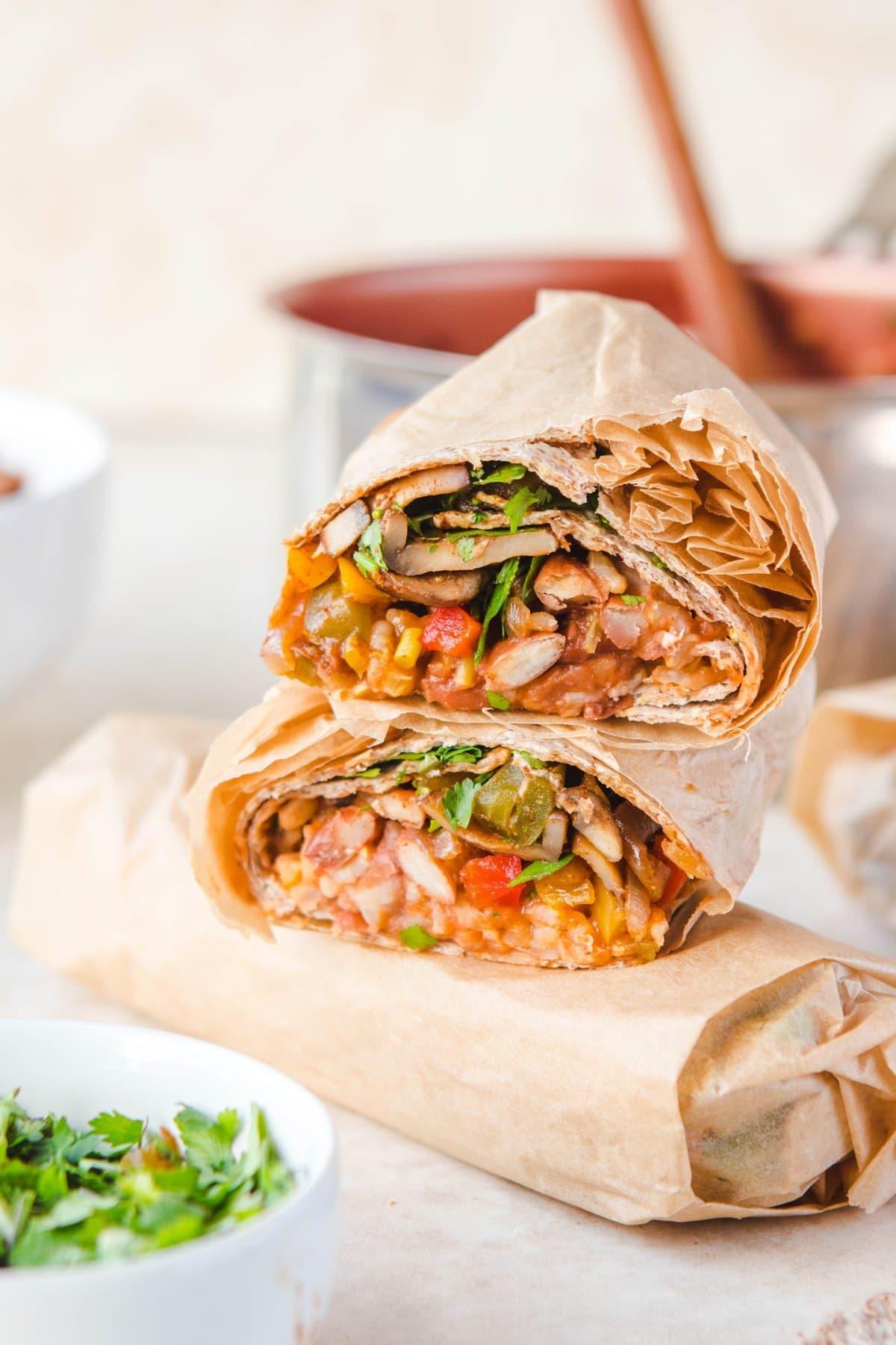 stack of rice and bean burritos