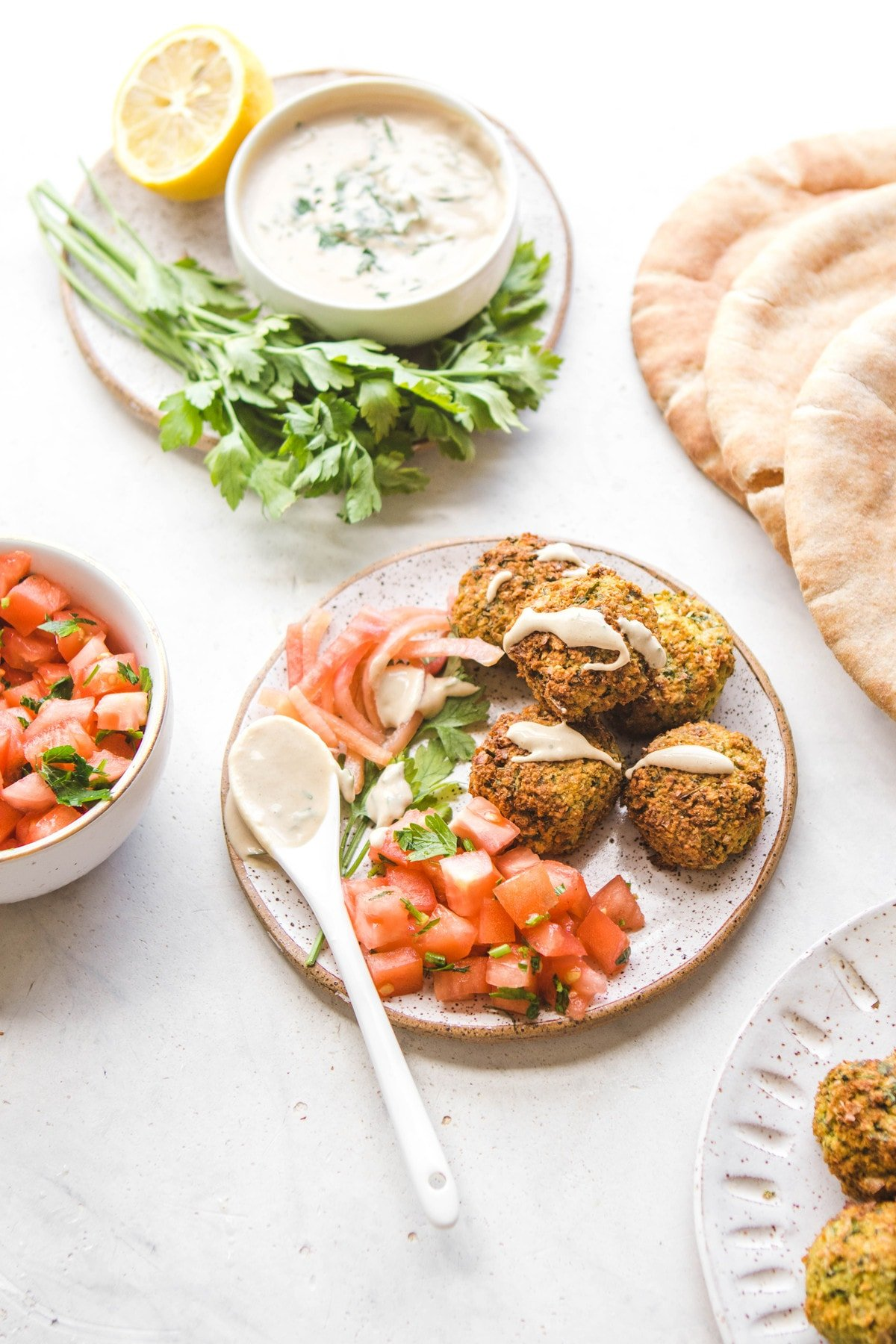 falafel with tahini sauce and chopped tomatoes