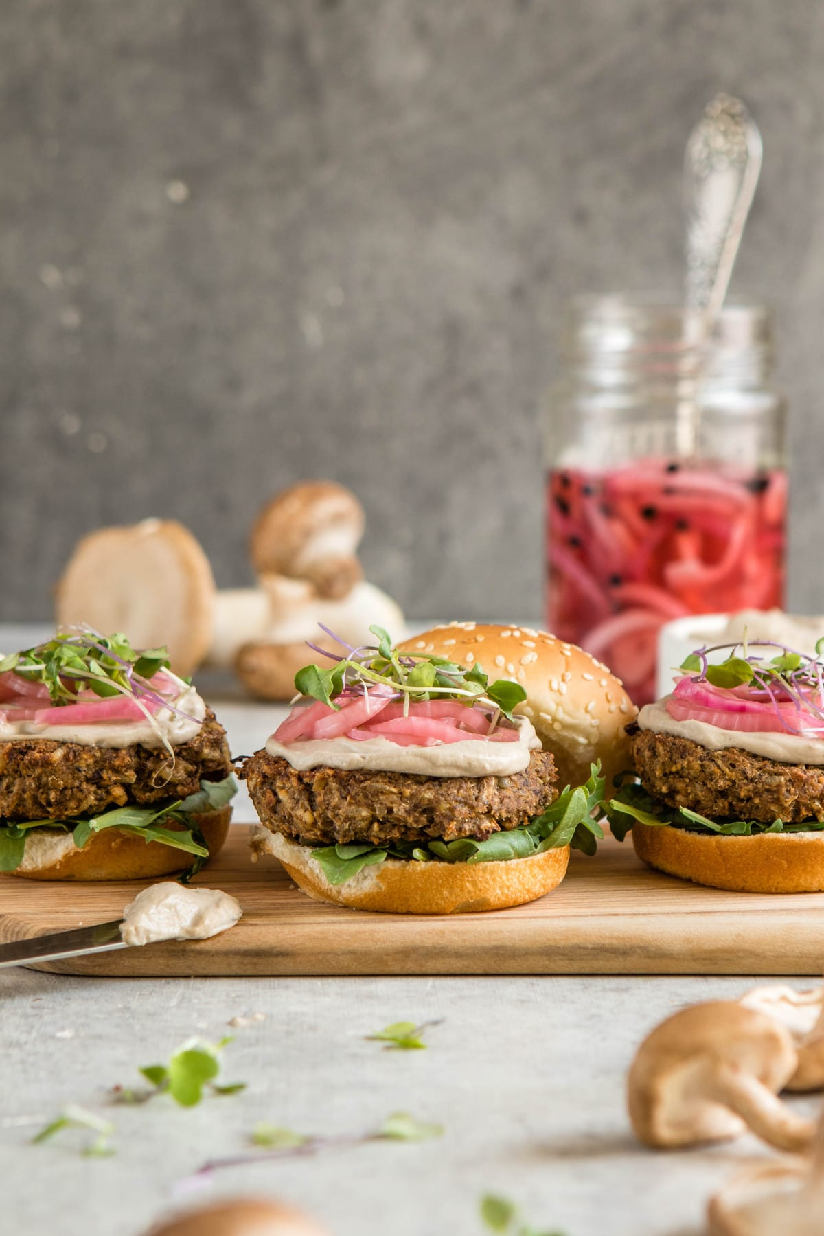 mushroom burgers on buns with pickled red onions