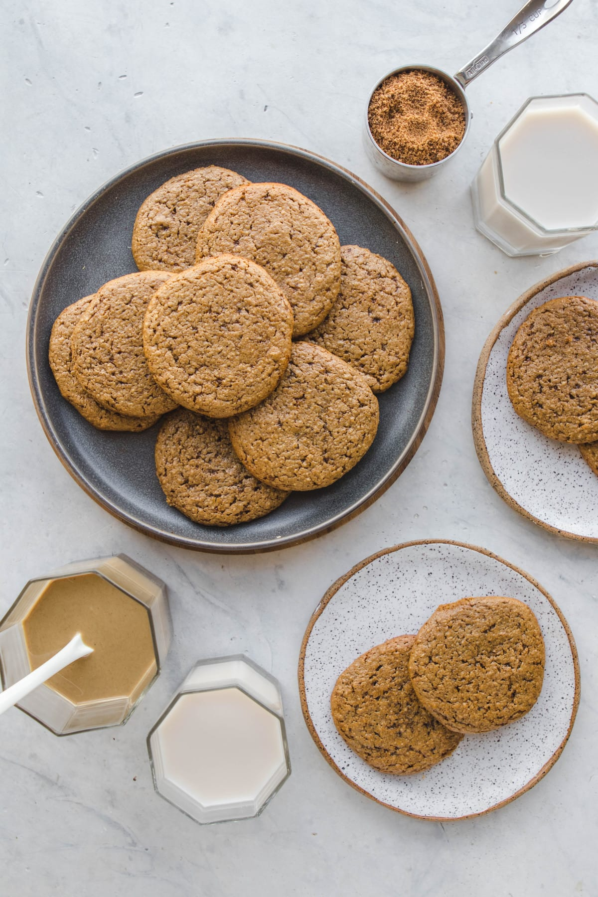 gray plate with tahini sugar cookies and white plate with cookies on top