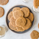 tahini sugar cookies on gray plate and white background