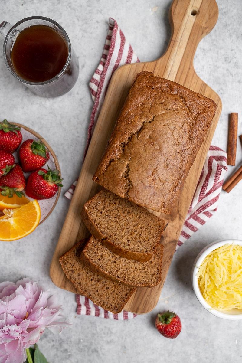 spaghetti squash bread on wood cutting board with fresh fruit