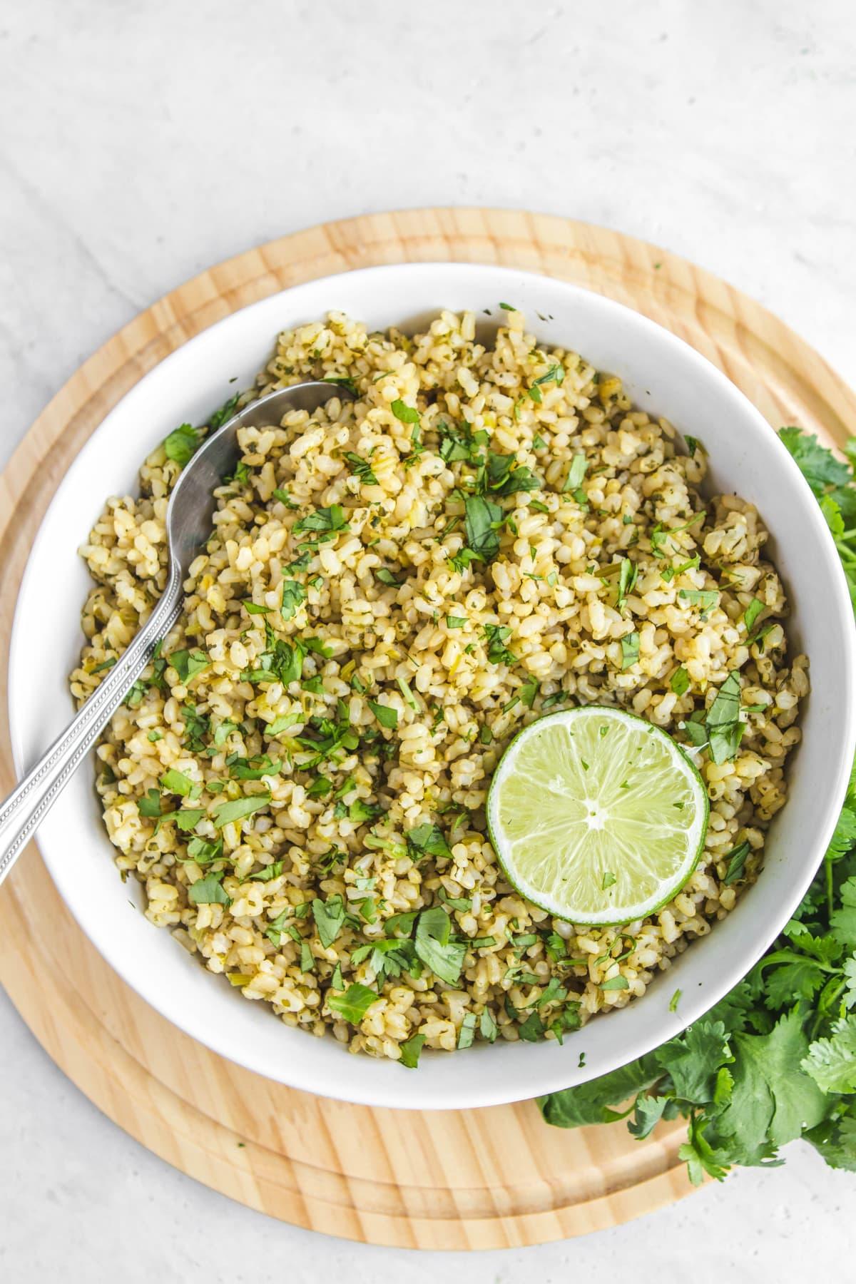 white bowl of cilantro lime rice with fresh cilantro