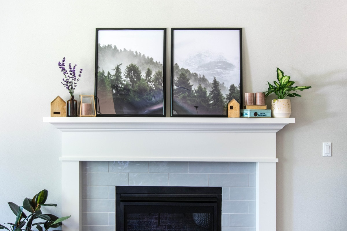 photos and miscellaneous decor over fireplace mantle