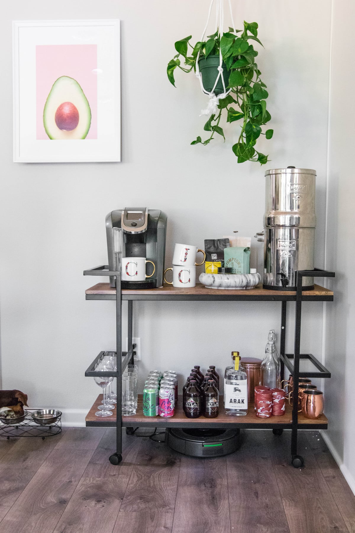 bar cart with mugs, coffee, and alcohol