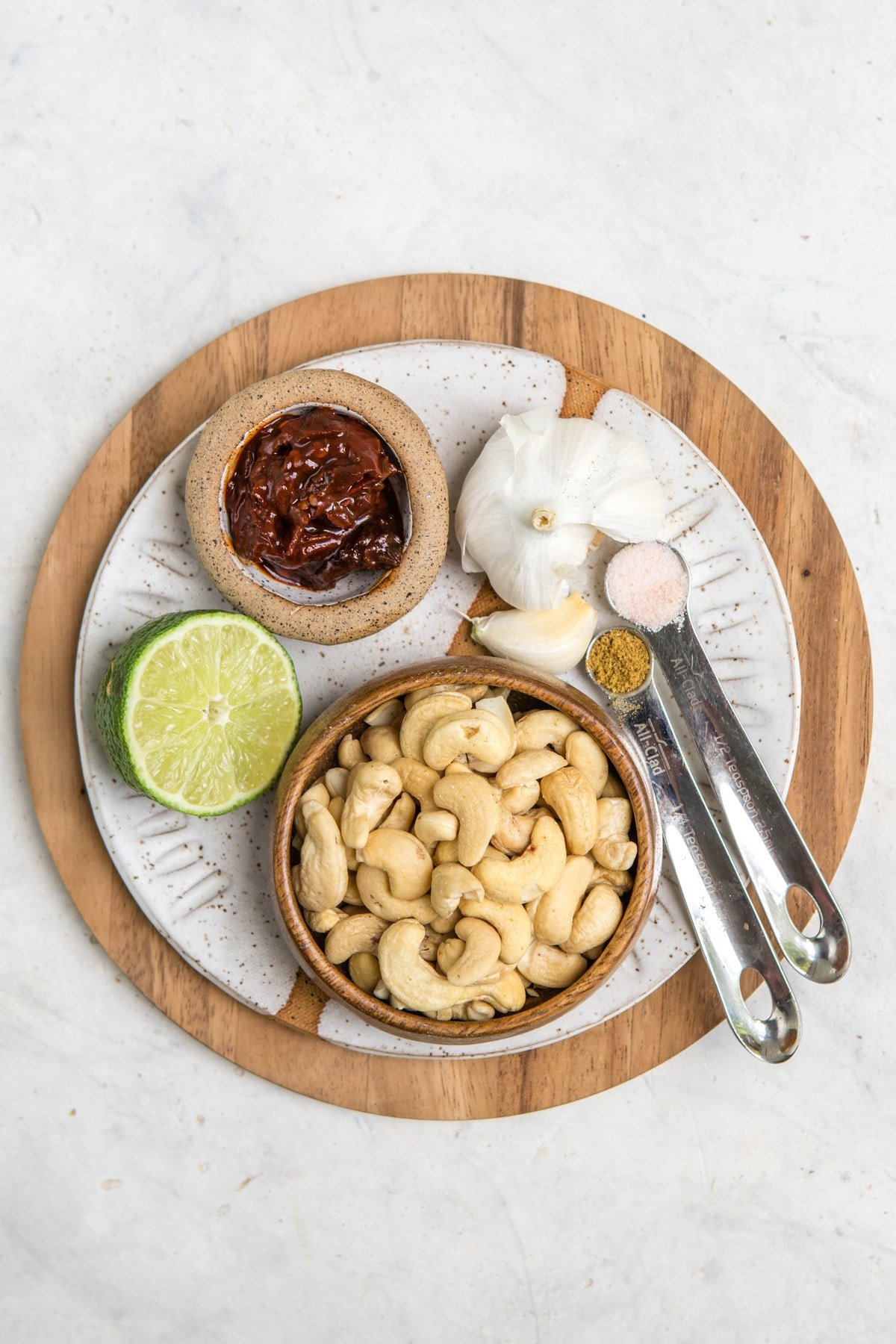 ingredients for chipotle mayo on white plate
