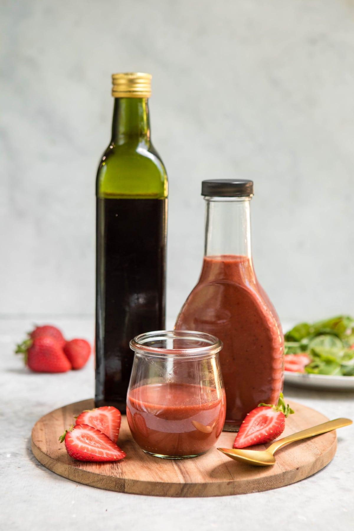 glass jars of roasted strawberry balsamic vinaigrette