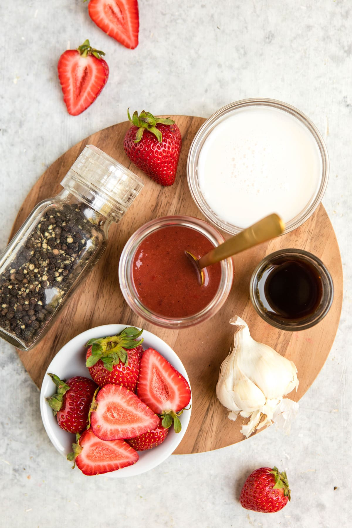 ingredients for roasted strawberry vinaigrette on cutting board