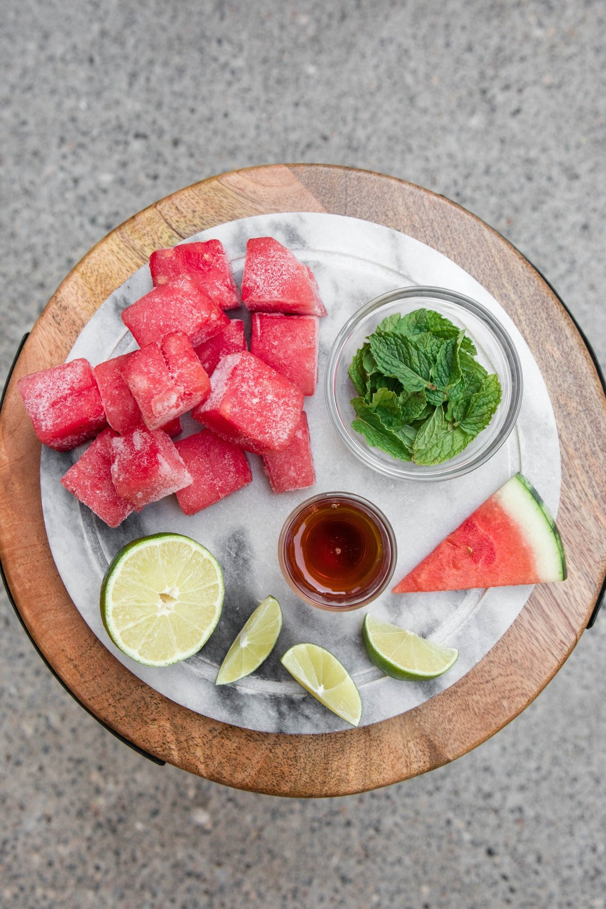 ingredients for watermelon slushie on marble cutting board