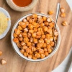 bowl of crispy buffalo chickpeas on wood cutting board