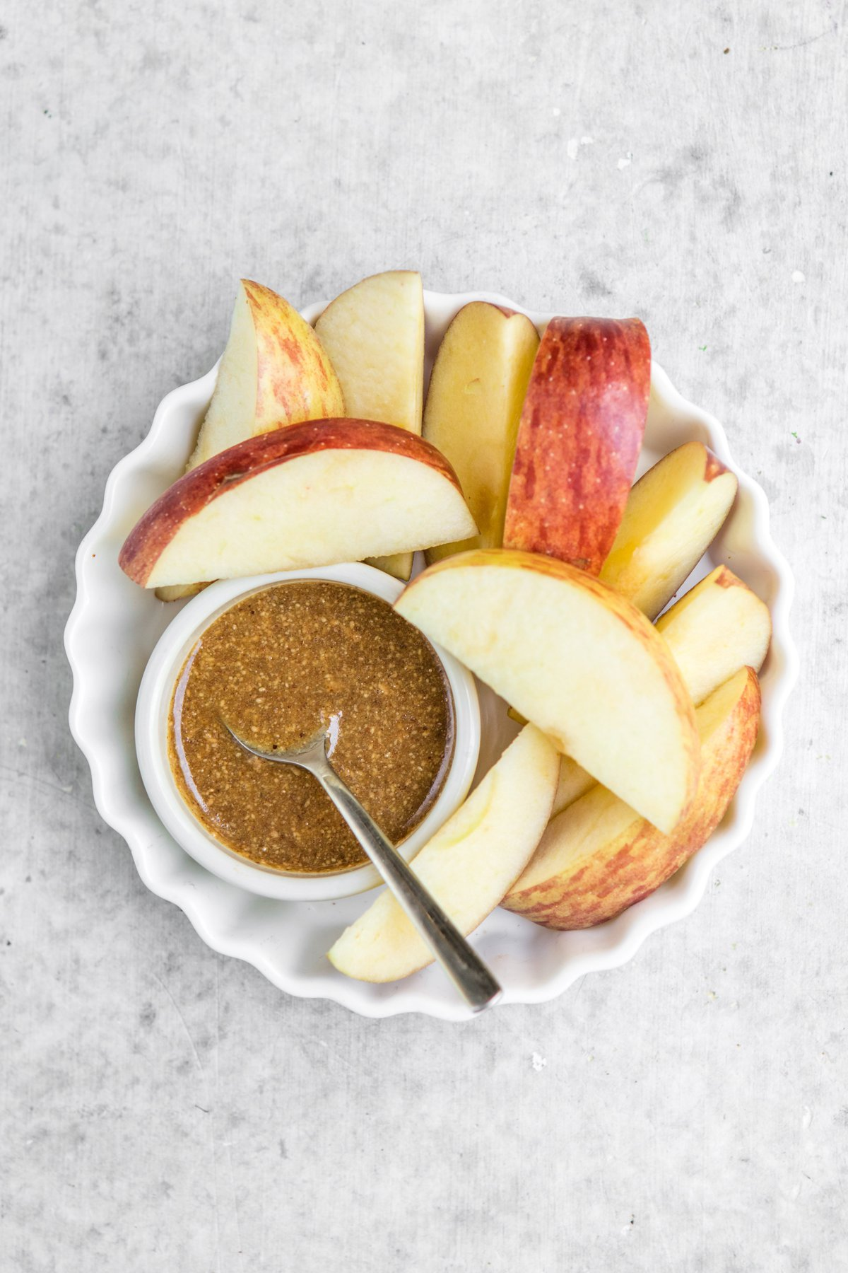 apples with healthy caramel sauce in white bowl