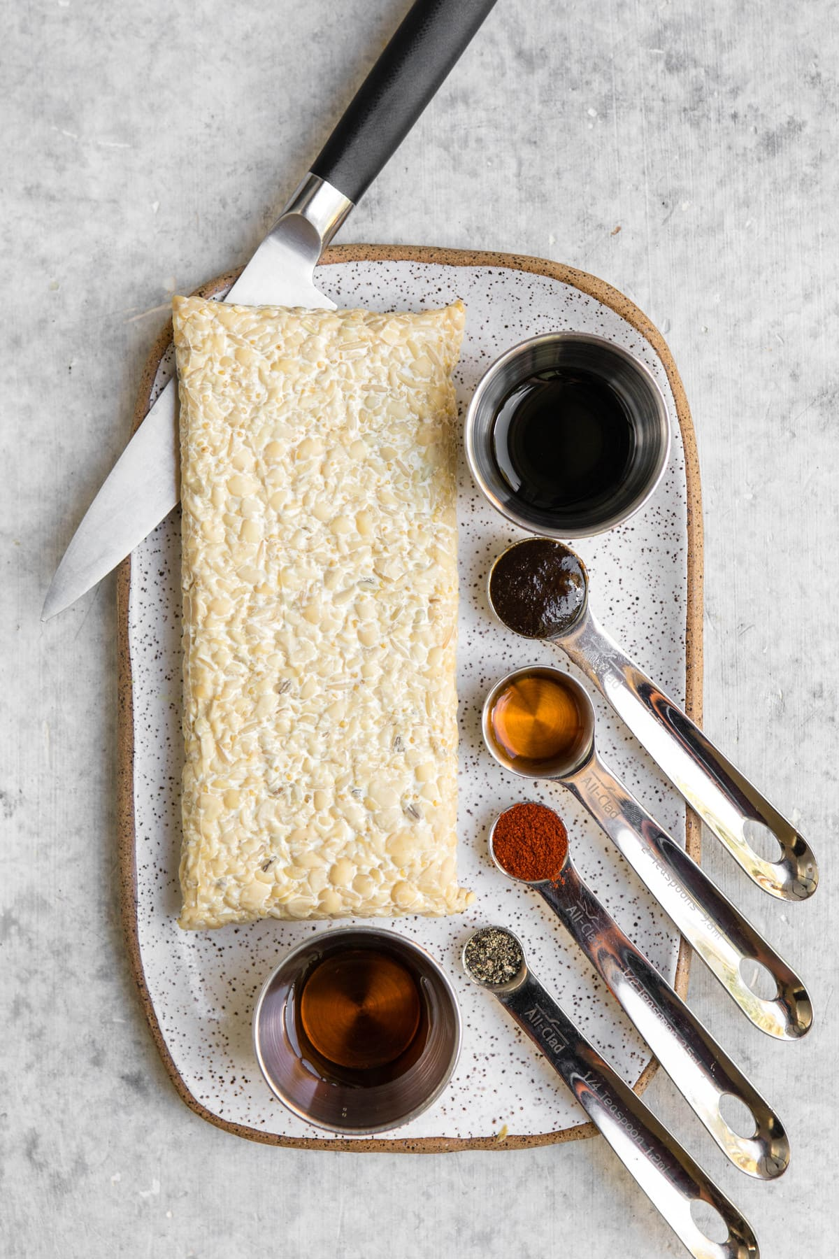 ingredients for smoky tempeh and block of tempeh on white serving tray