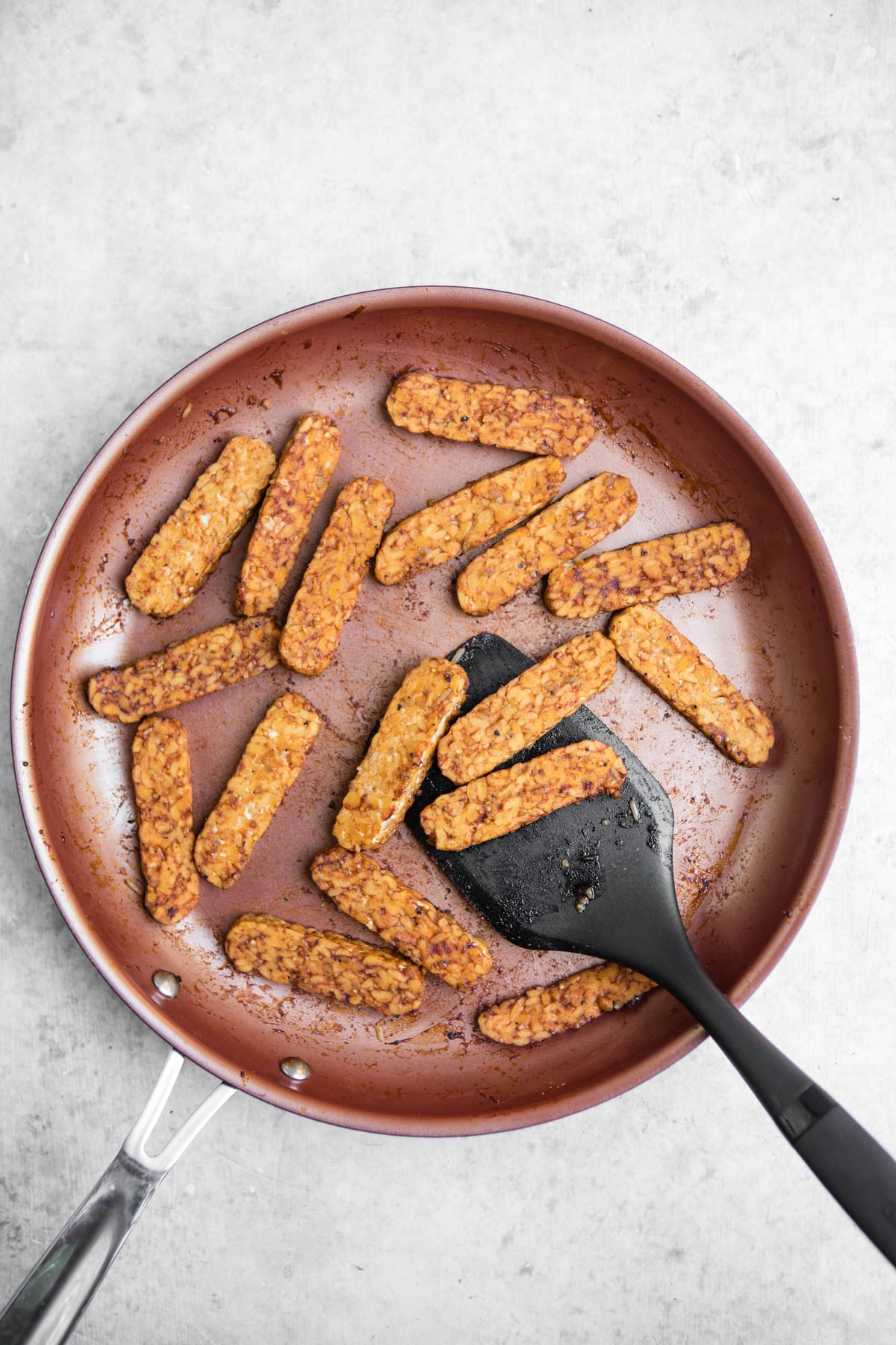 cooked tempeh in nonstick pan