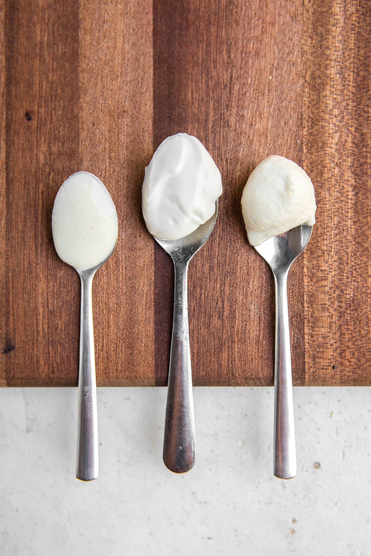 spoons of tofu, store-bought, and cashew mayo