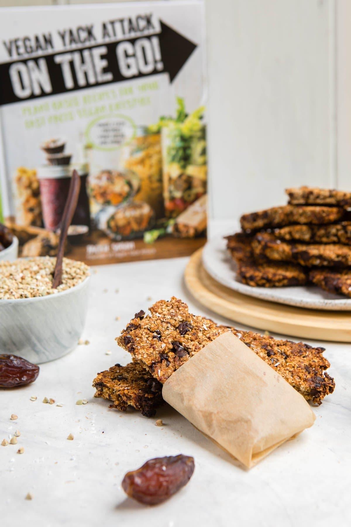 vanilla chip buckwheat bars with vegan yack attack cookbook in the background