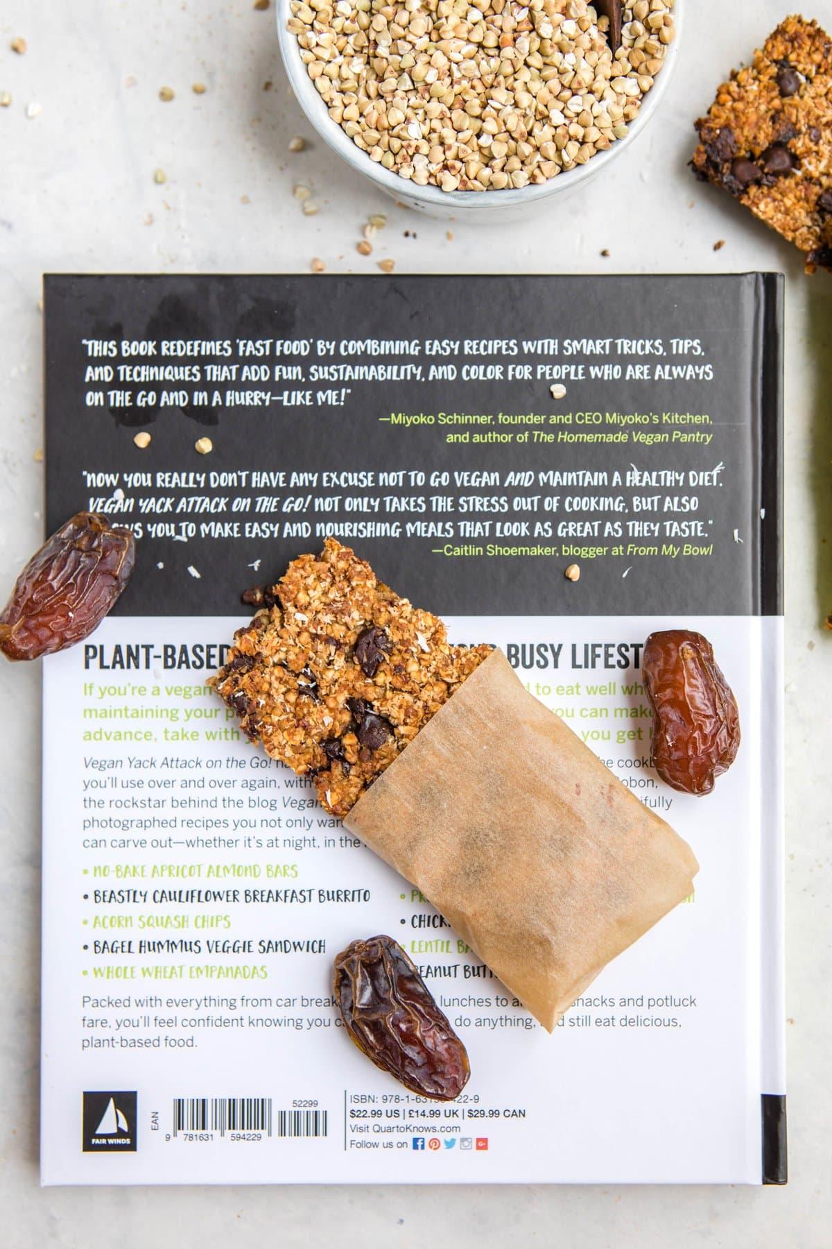 vanilla chip buckwheat bar on top of vegan yack attack on the go book