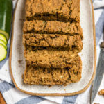 sliced zucchini bread on white serving tray