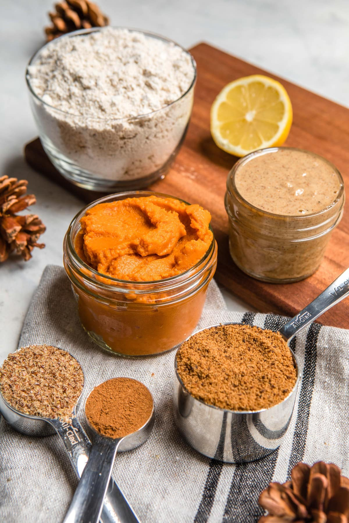 ingredients for pumpkin bread on white background