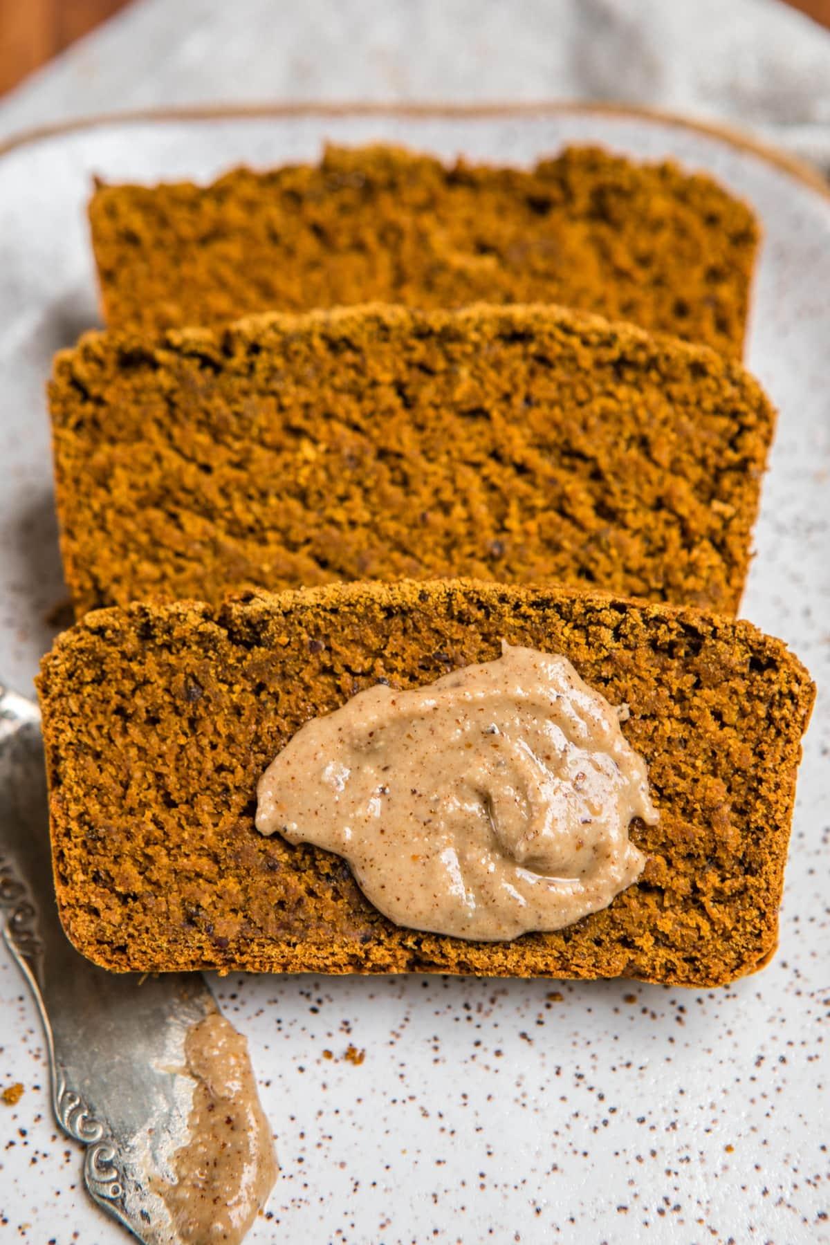slice of vegan pumpkin bread with swirl of hazelnut butter on top