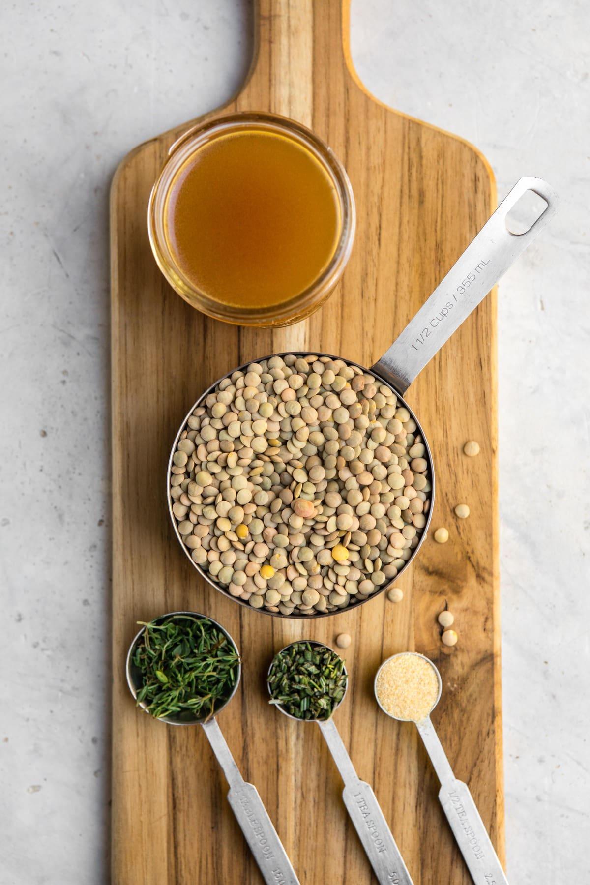 ingredients for rosemary garlic lentils on wood cutting board