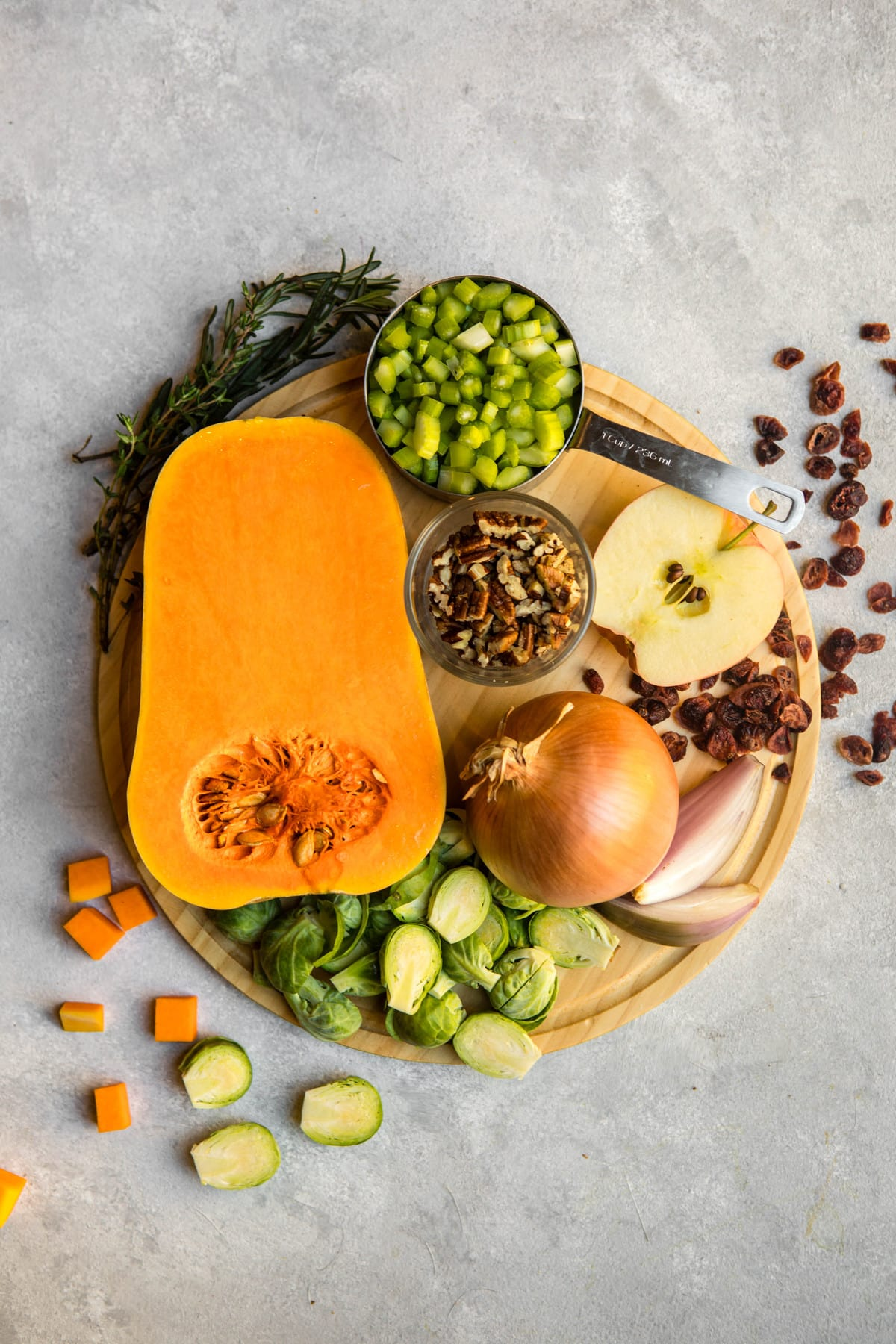 ingredients for roasted vegetable casserole on round wood cutting board