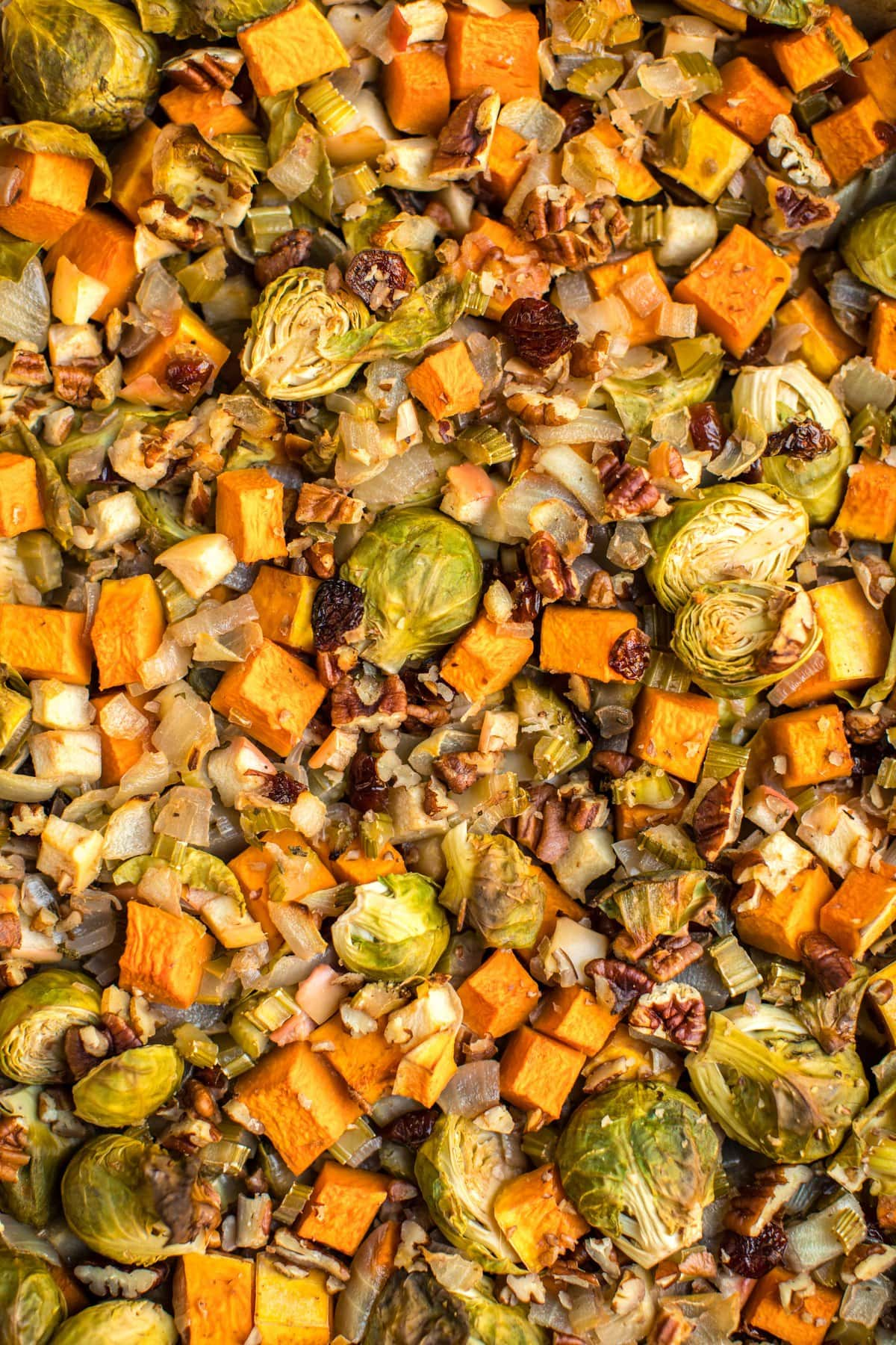 close up photo of roasted vegetable casserole topped with pecans