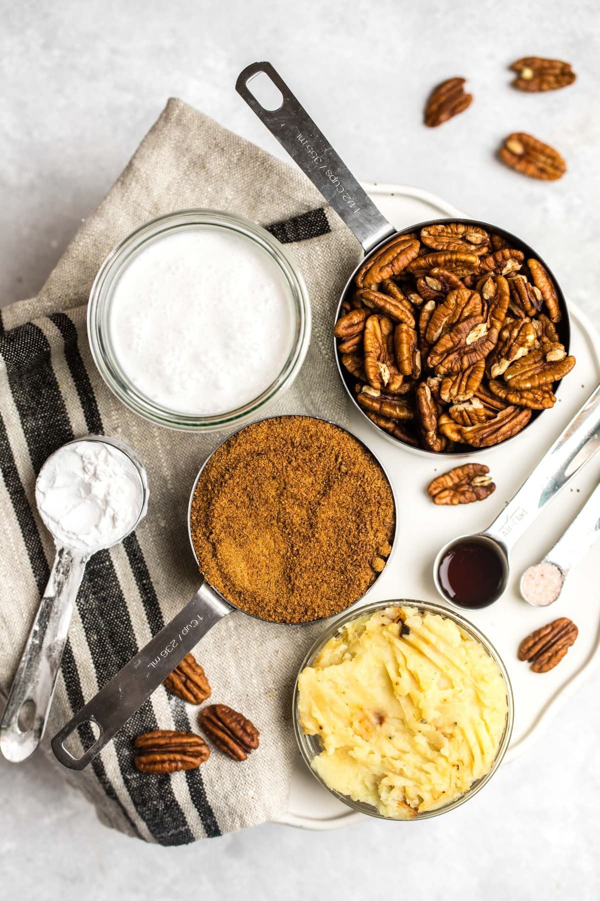 ingredients for pecan pie on marble cutting board