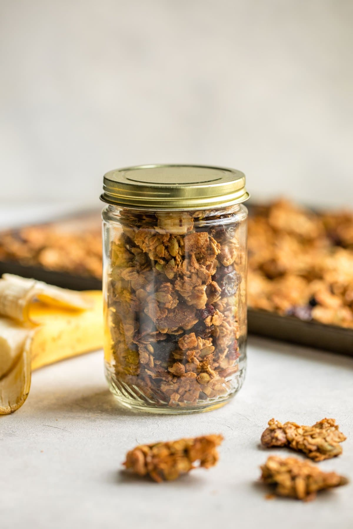 easy vegan granola in sealed glass mason jar with gold lid