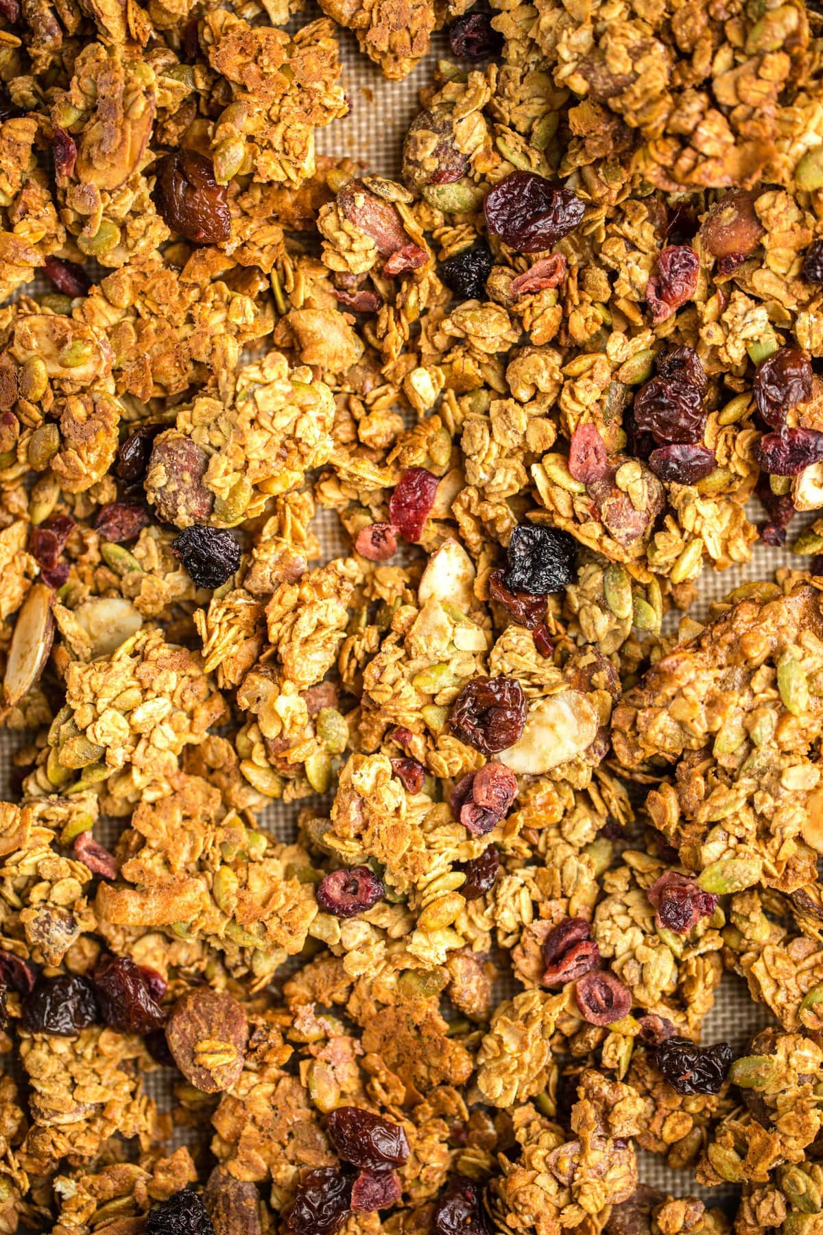 close up photo of crispy baked granola clusters on baking sheet