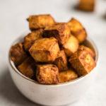 crispy tofu in white bowl with gold rim