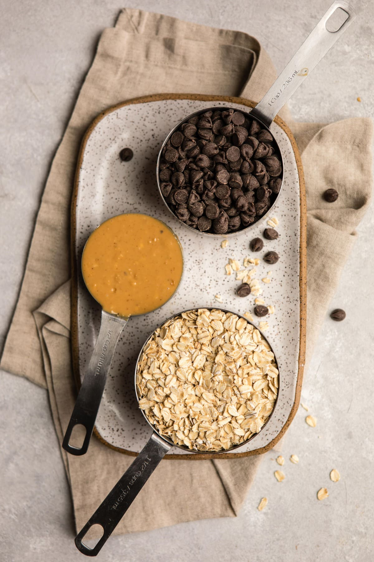ingredients for no-bake peanut butter cookies on white speckled serving platter