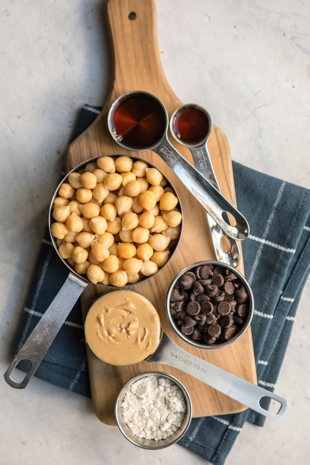 ingredients for chickpea cookie dough on wood serving platter