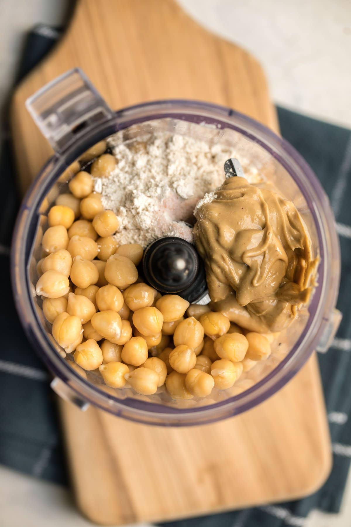 ingredients for chickpea cookie dough in food processor before being blended