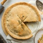 chickpea pot pie with slice cut out of it with on grey stone background