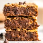 stack of peanut butter brownies on white speckled plate