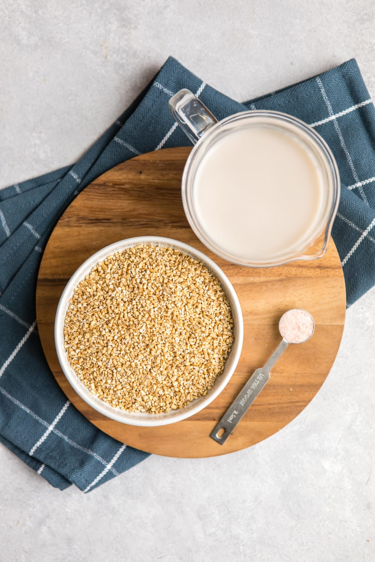 ingredients for instant pot oatmeal on round wood cutting board