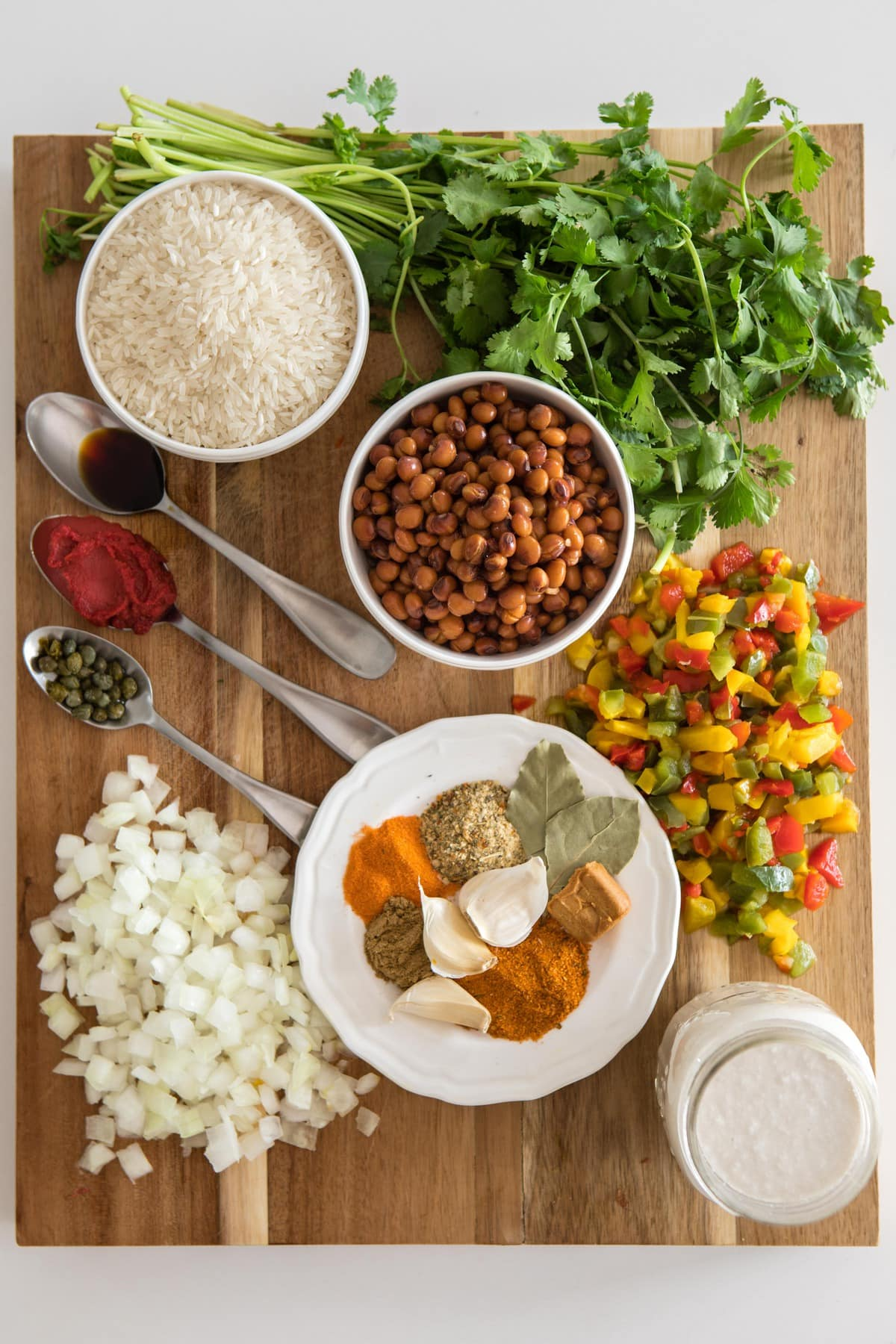ingredients for arroz con guandules on wooden cutting board