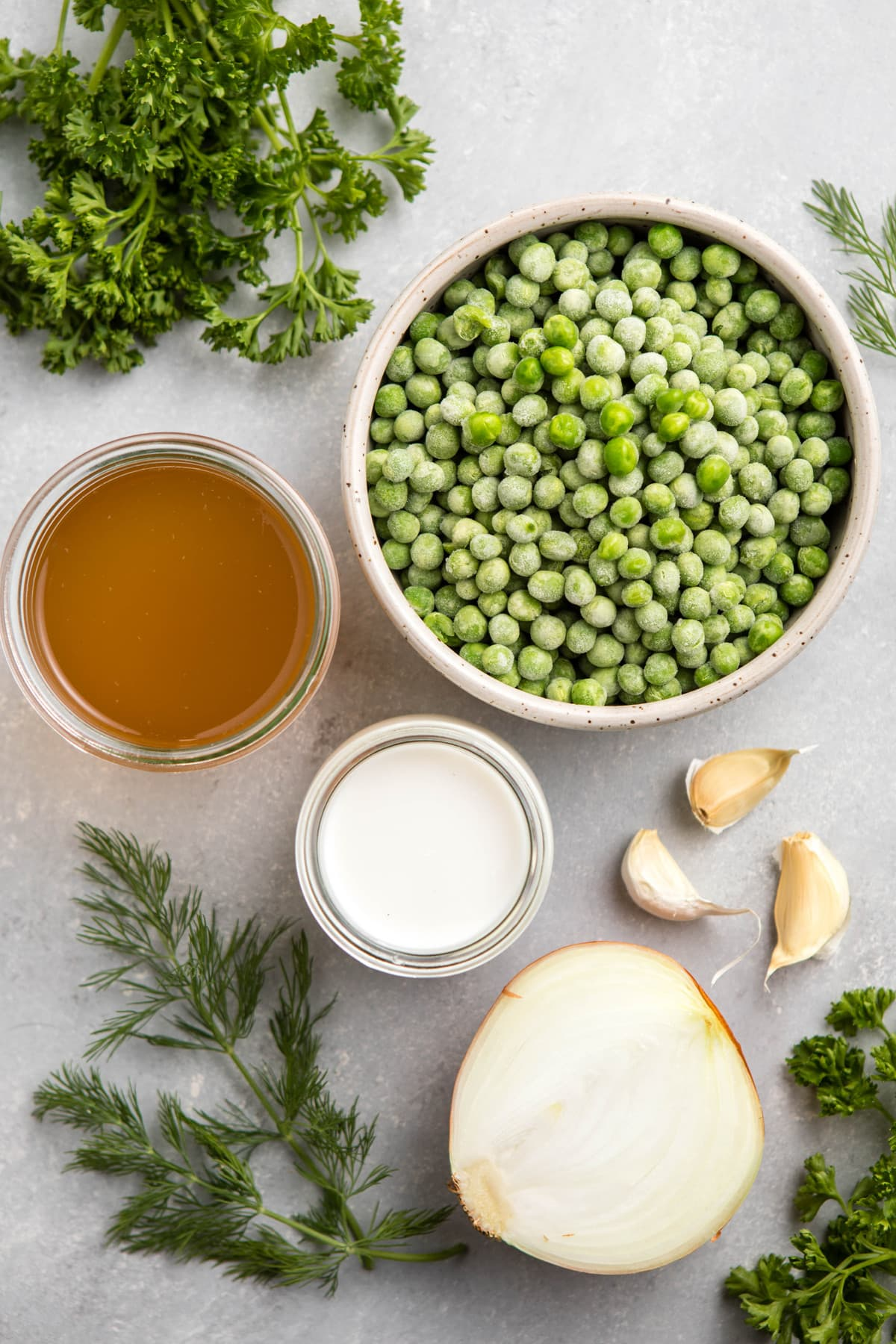 ingredients for pea soup on gray textured background