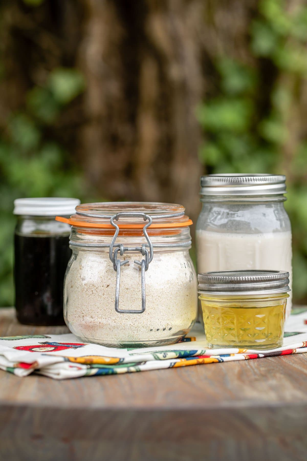 glass jars of pancake dry mix and other ingredients to make camping pancakes
