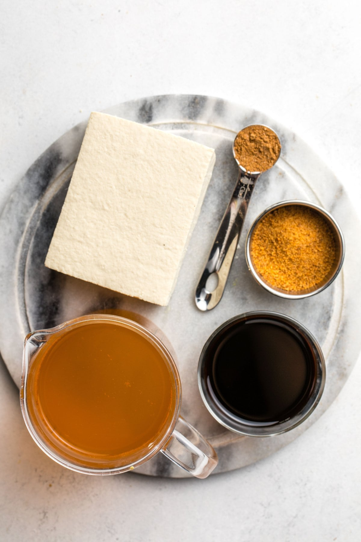 ingredients for braised tofu on marble cutting board